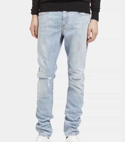 Distressed Low Waisted Jeans by Saint Laurent