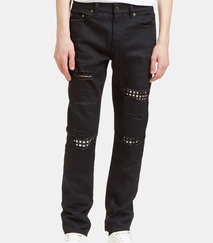 Destroyed Studded Leather Patch Jeans by Saint Laurent
