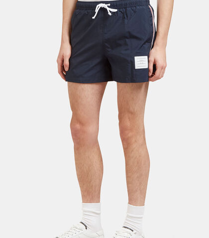 Striped Grosgrain Trimmed Swim Shorts by Thom Browne