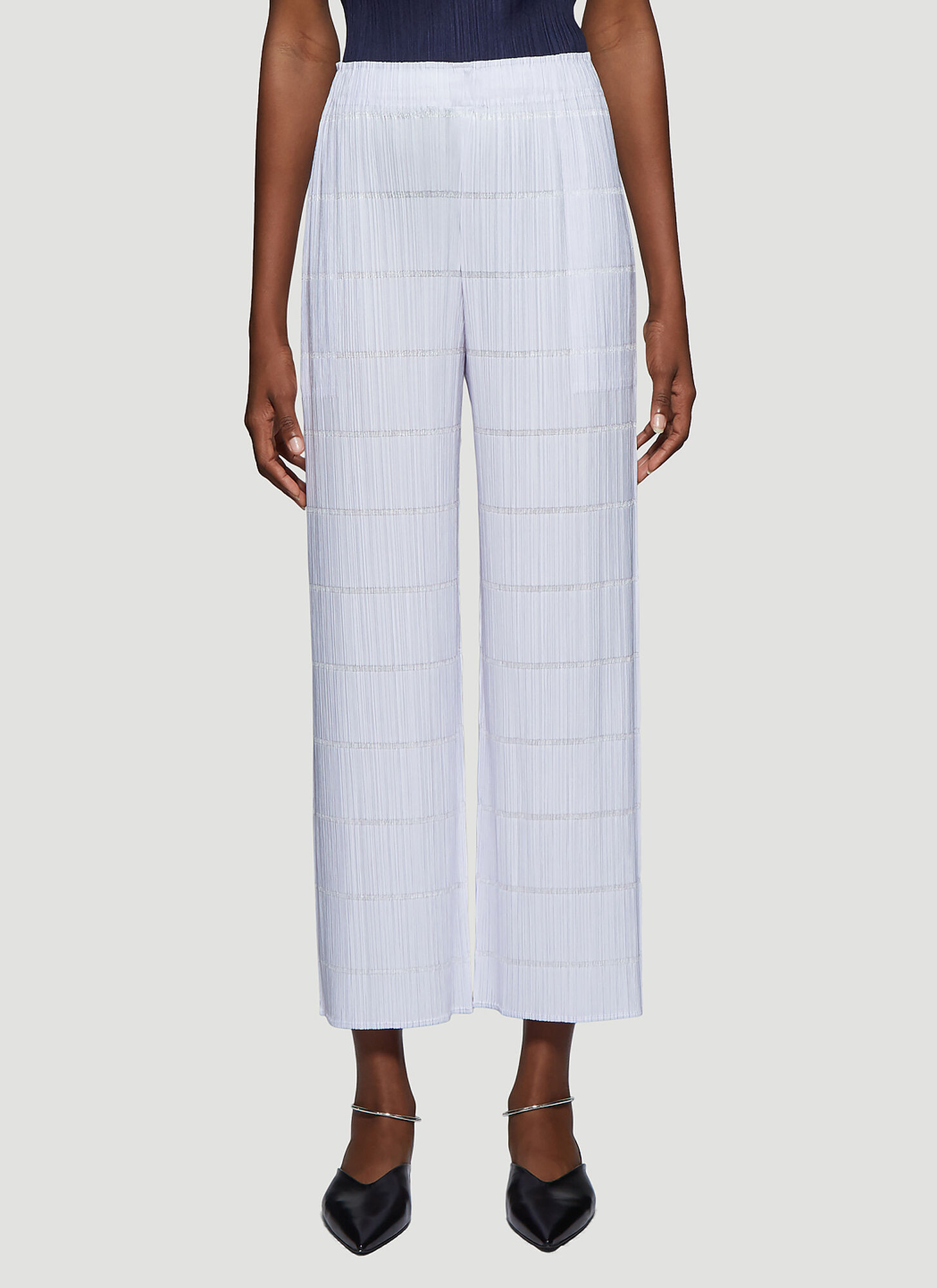 Photo of Pleats Please Issey Miyake Pleated Pants in Purple - Pleats Please Issey Miyake Pants