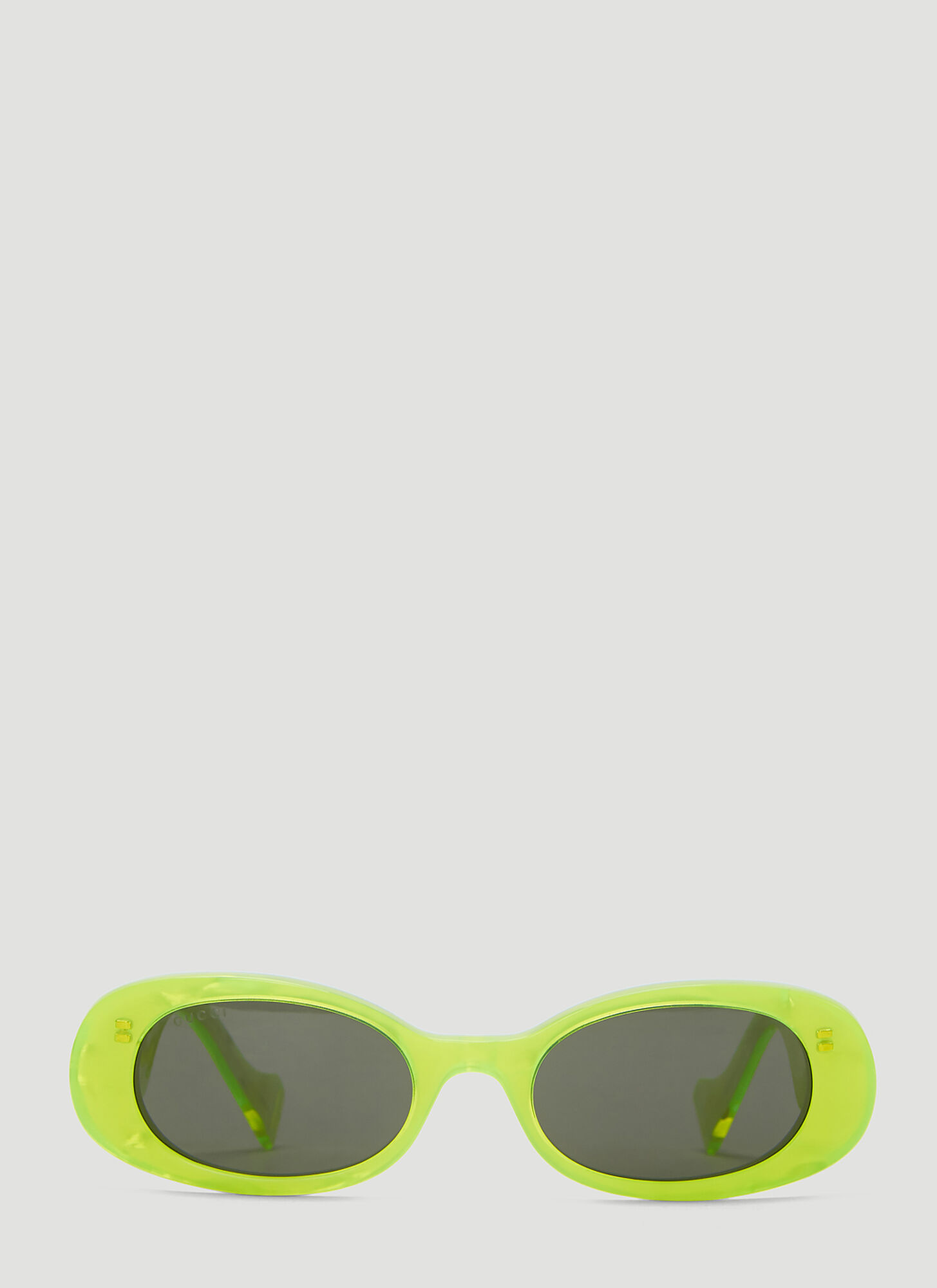 Gucci Oval Sunglasses in Yellow