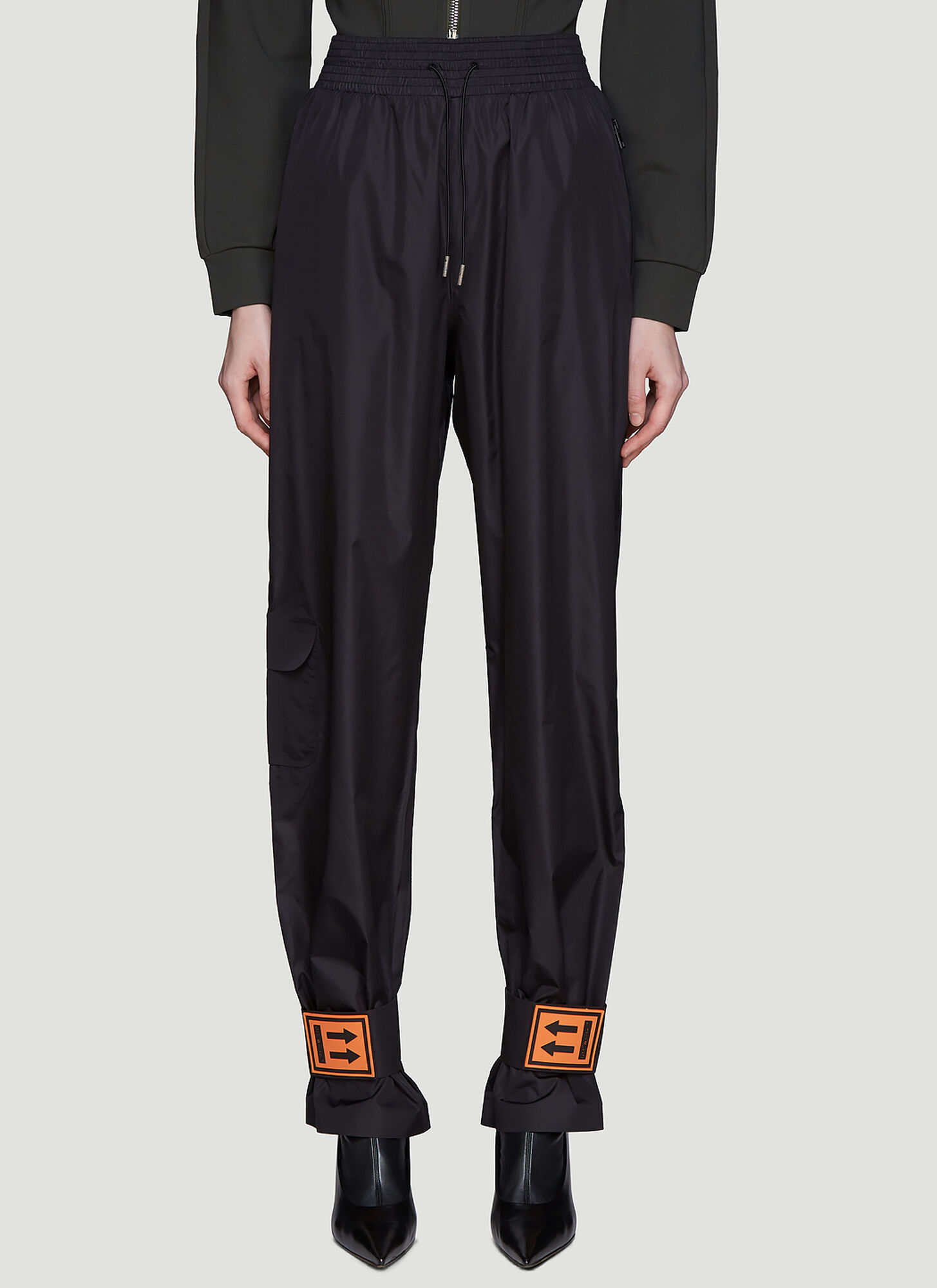 OFF-WHITE | Off-White Nylon Track Pants in Black size IT - 42 | Goxip