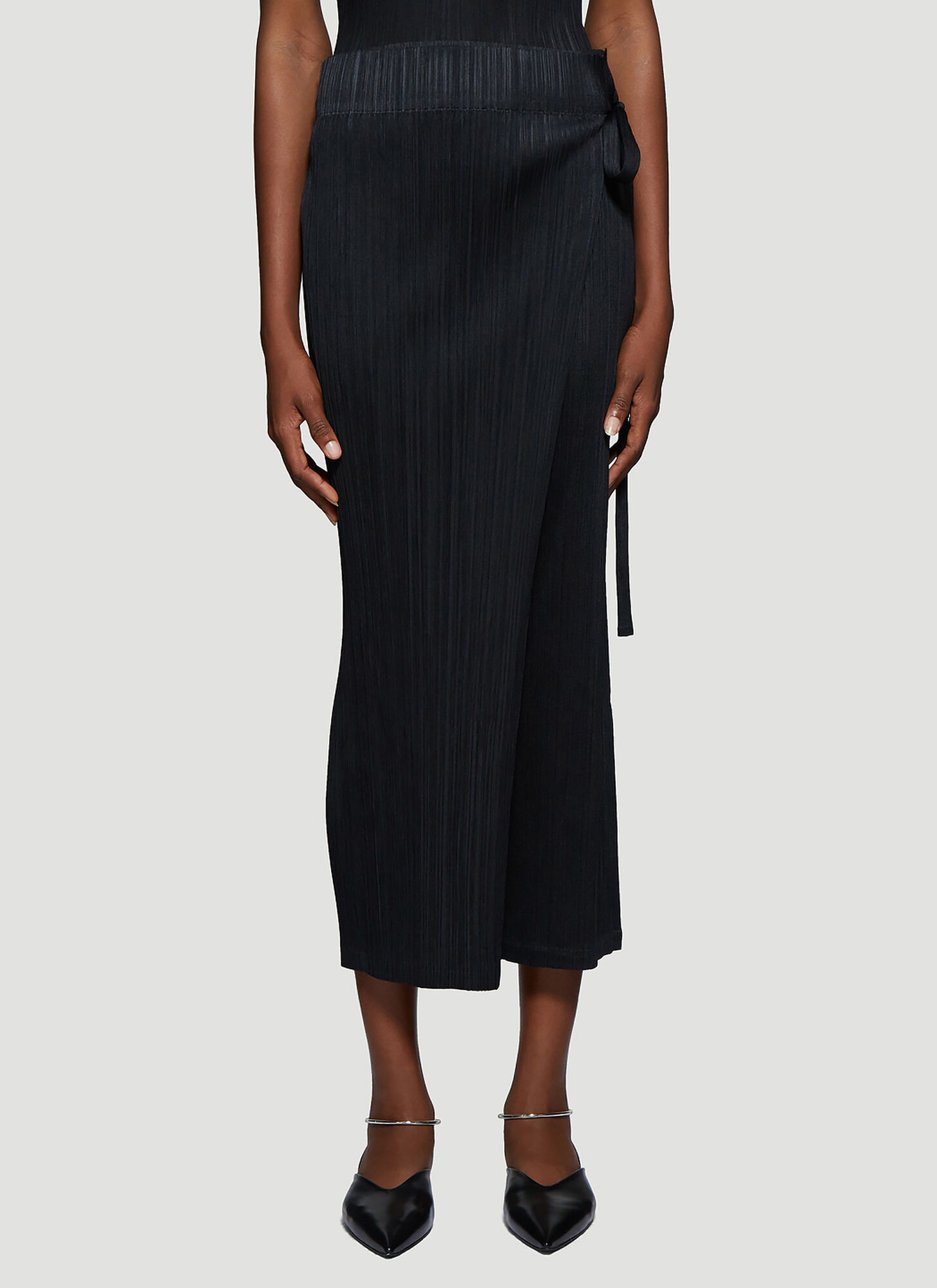 Photo of Pleats Please Issey Miyake Pleated Wrap Pants in Black - Pleats Please Issey Miyake Pants