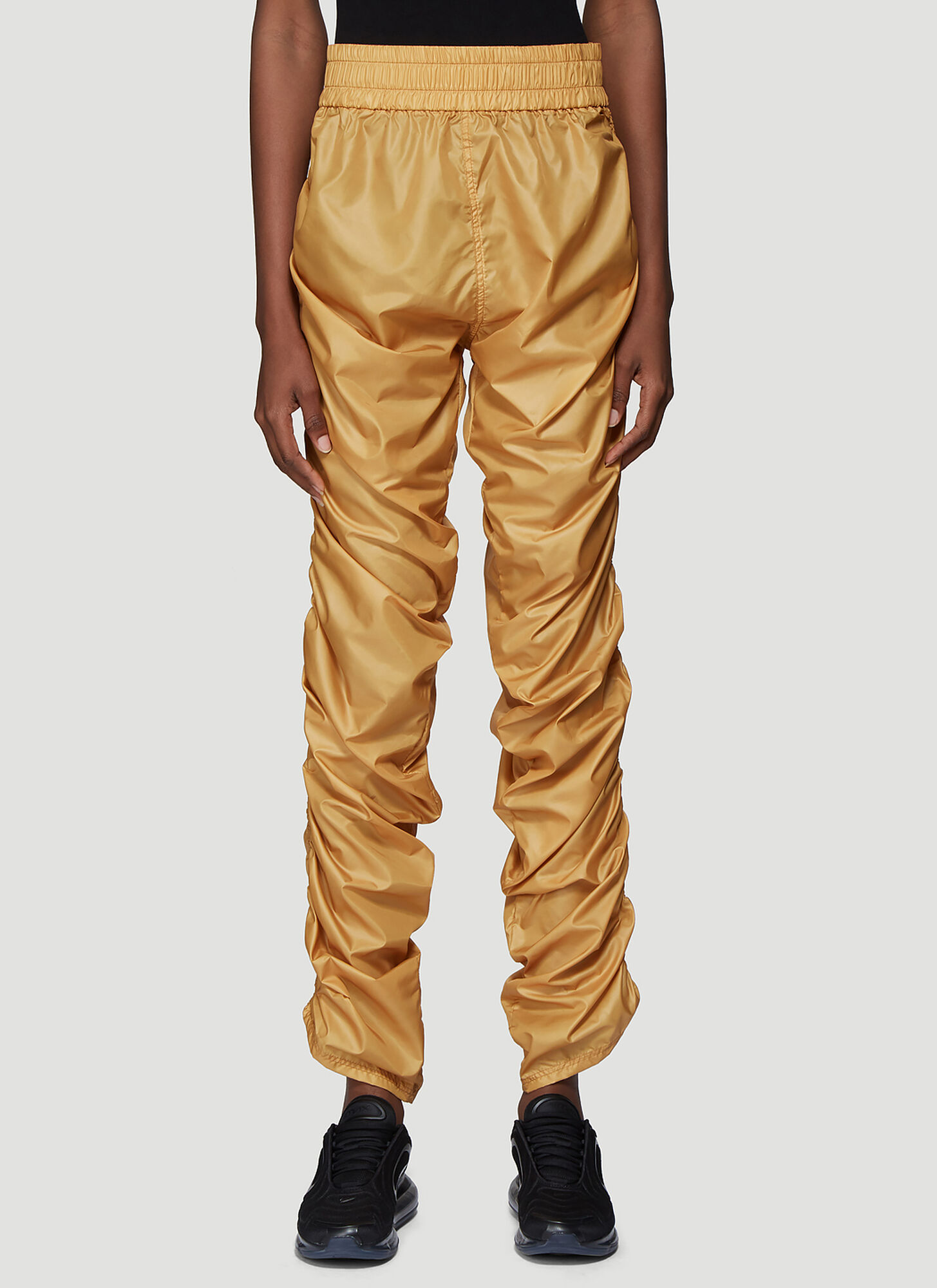 Laerke Andersen Compression Track Pants in Yellow