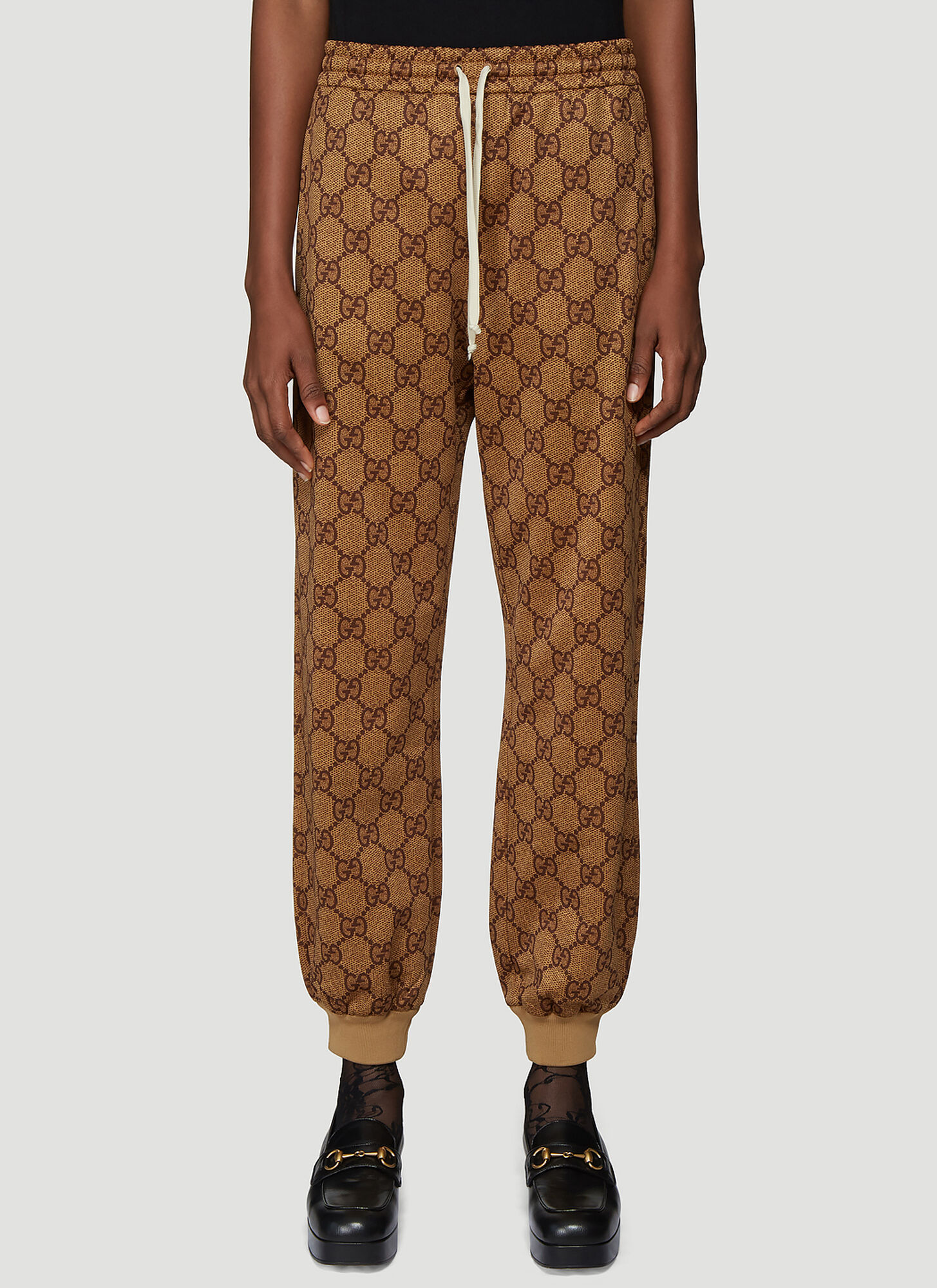Gucci GG Print Track Pants in Brown